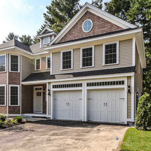 exterior of home with drive under garage>