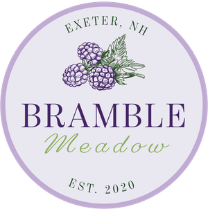 bramble meadow logo with purple circle and blackberries