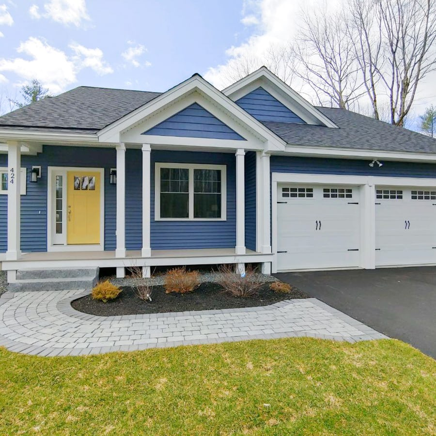 blue ranch style home with yellow door