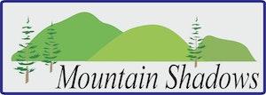mountain shadows logo with trees