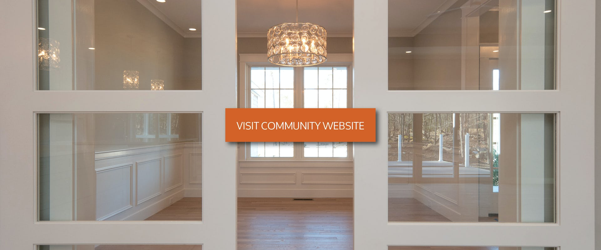 french doors with visit community website button