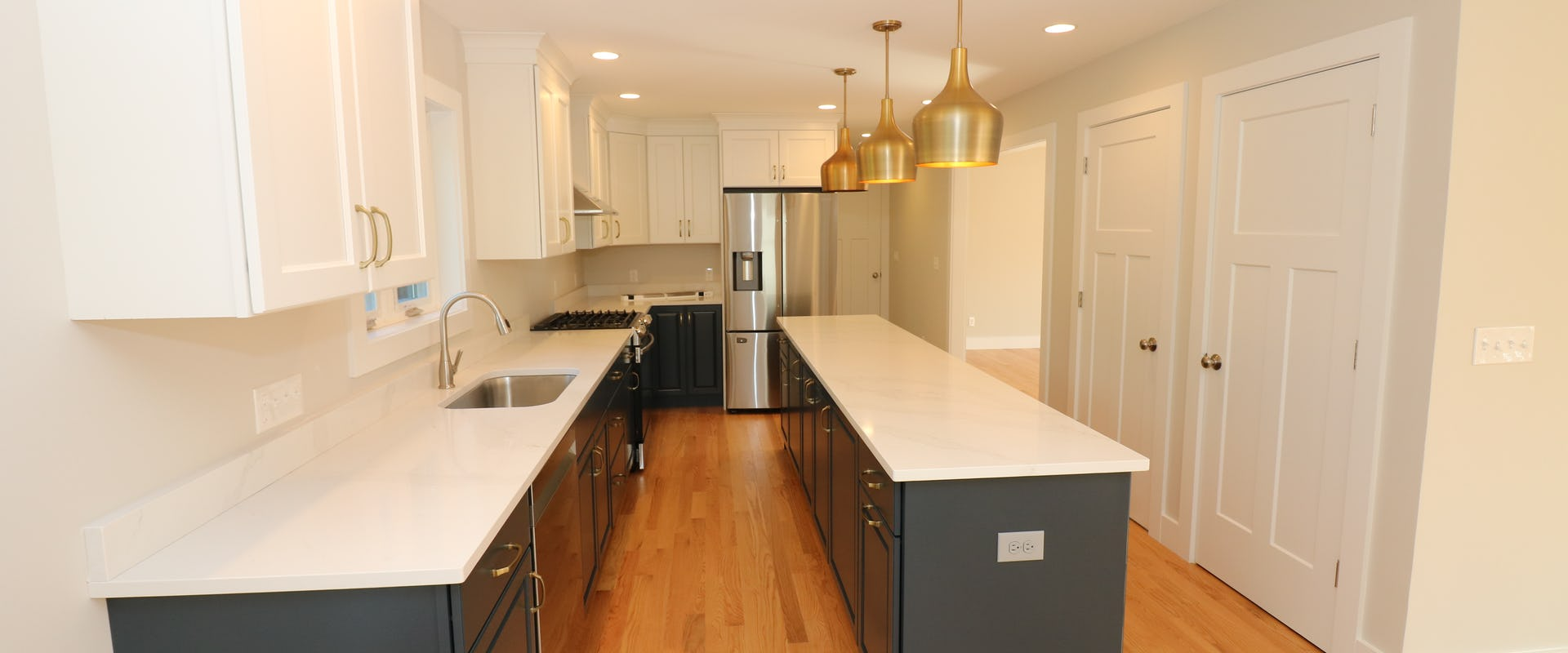 kitchen with dark cabinets and gold accents