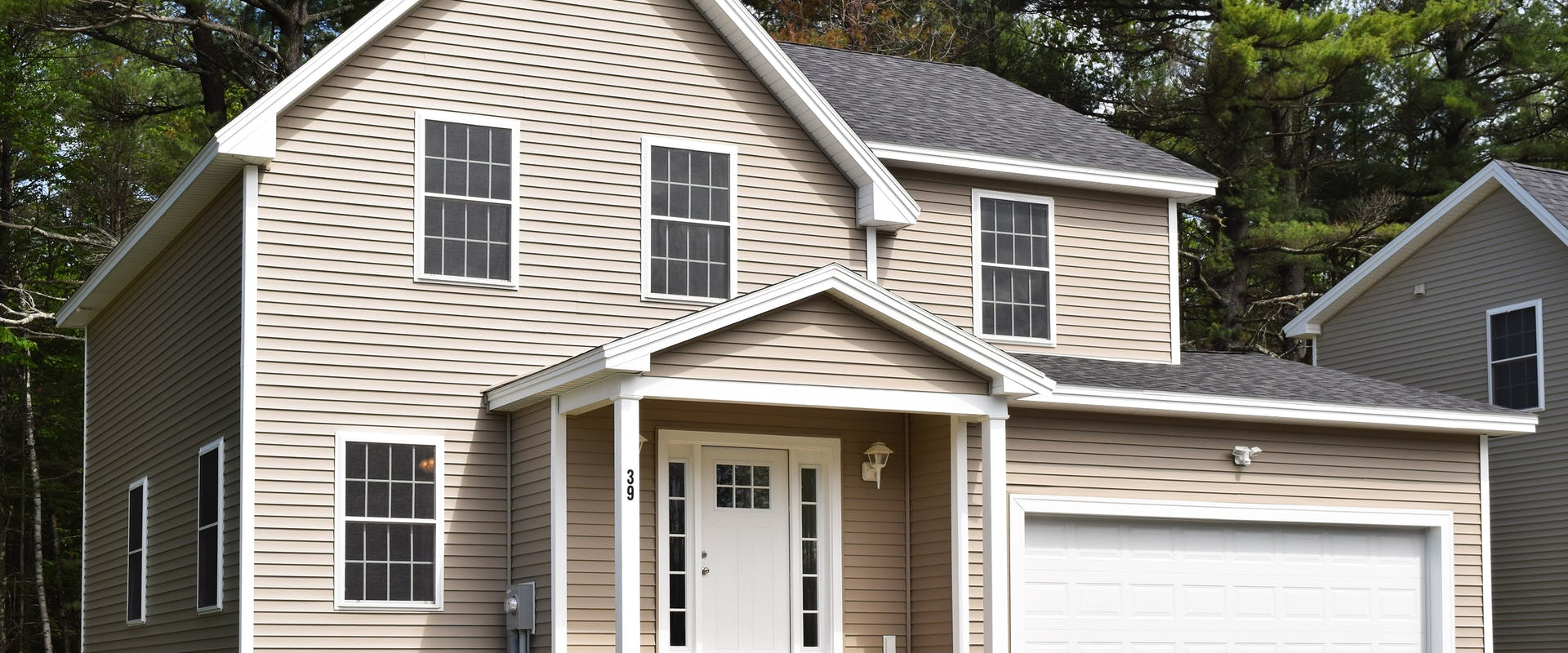 beige home with front porch