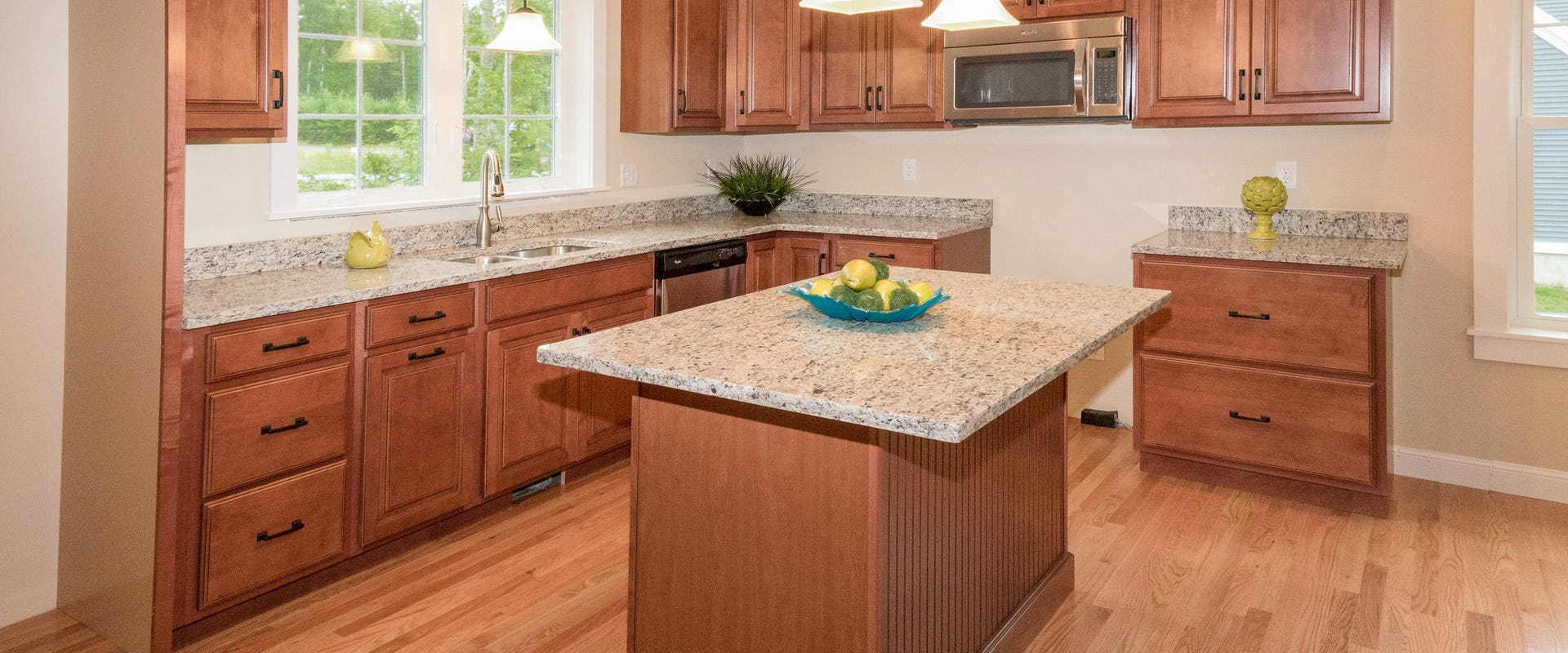 maple kitchen with granite counters in new home