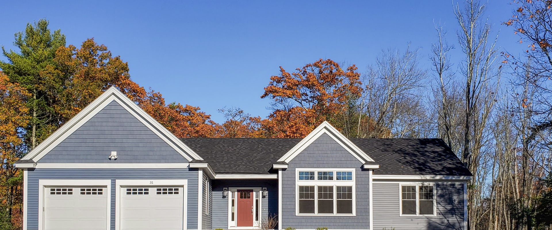 blue ranch style home in fall