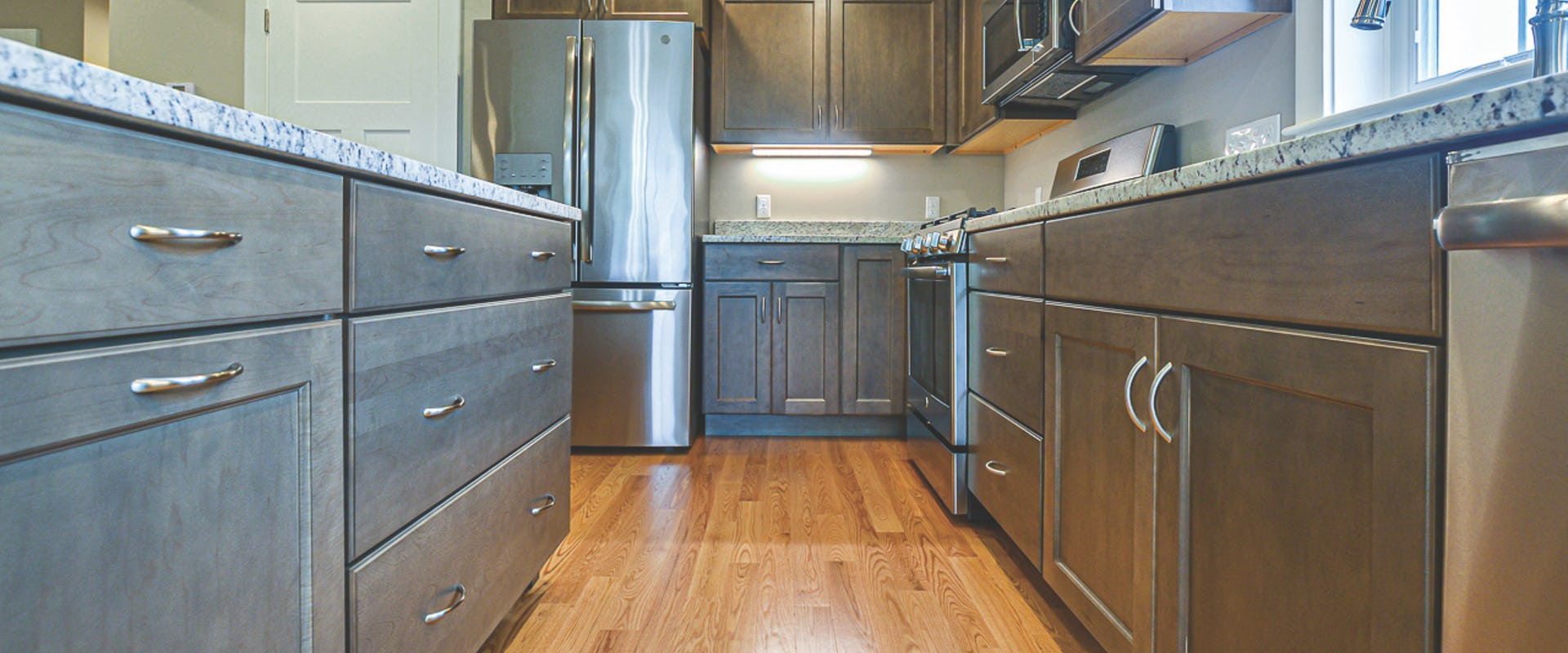 grey kitchen with granite counters in new home