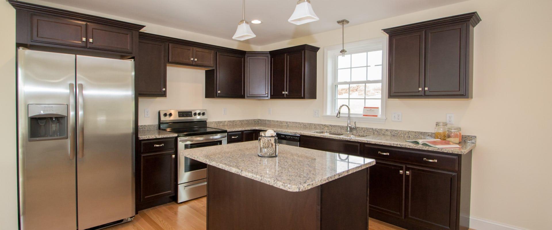 dark kitchen cabinets in new home